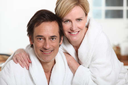 wife of bath: Couple relaxing at home in dressing gowns