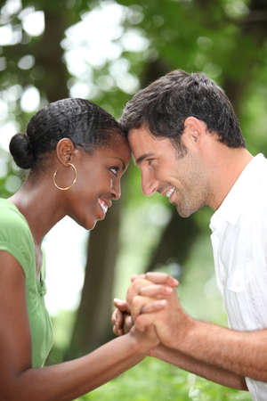 mixed races: Happy romantic couple