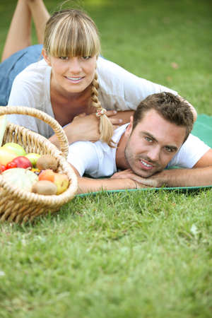 Couple having a romantic picnic together photo