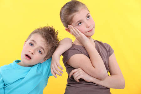 bored face: Brother and sister bored. Stock Photo