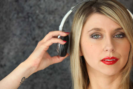 stuck up: Woman putting on a pair of headphones