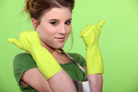 housewife gloves: Young women wearing rubber gloves and apron
