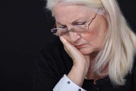 deep thought: Depressed elderly woman Stock Photo