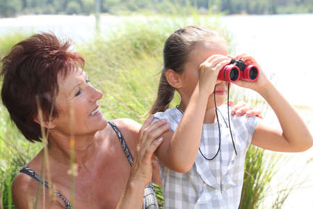 Little girl with pair of binoculars photo