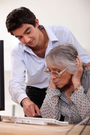 grannies: grandson learning his grandmother haw to use a computer