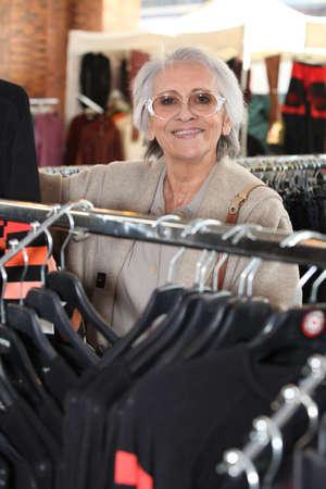 65 70 years: Elderly woman shopping Stock Photo