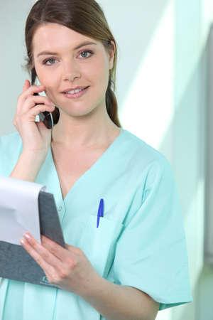 Nurse on the phone Stock Photo