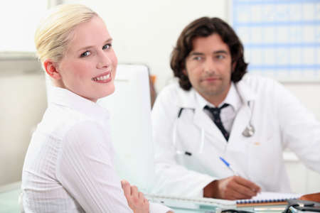 woman consulting her doctor photo