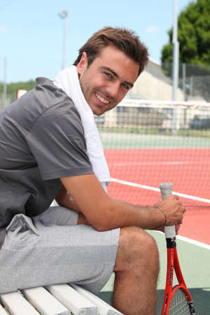 player bench: Tennis player sitting on the bench