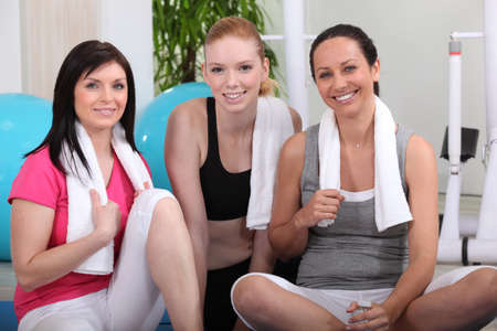 Young women in gym club photo