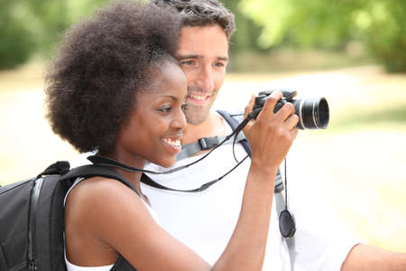 adventurers: couple of tourists looking a camera Stock Photo