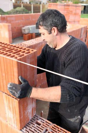 Bricklayer building wall photo