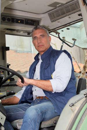 portrait of a farmer in tractor photo