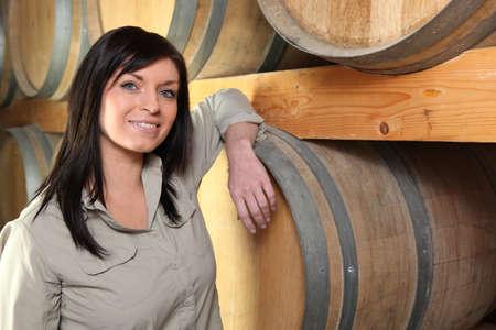 winemaker: Winemaker in her cellar Stock Photo