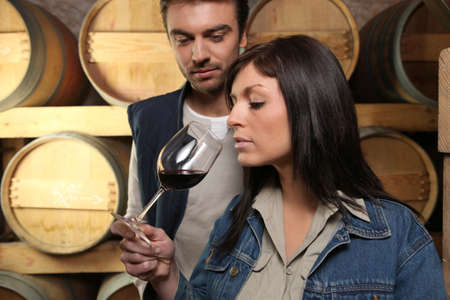 oenology: Winegrowers tasting a wine