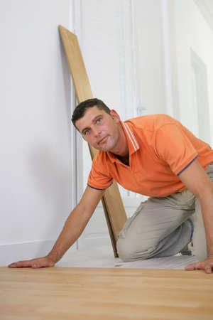 Handyman laying laminate floor Stock Photo - 11774839