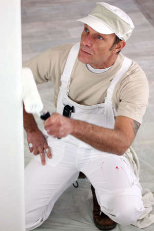 painter and decorator: Tradesman painting a wall