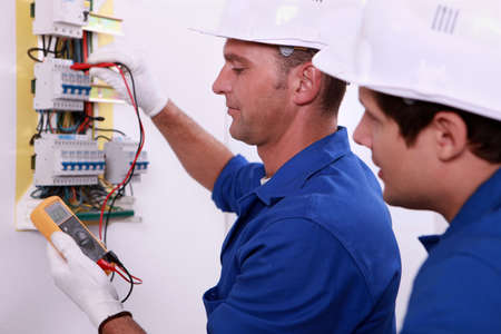 wiring: Electrical inspectors at work Stock Photo