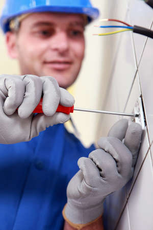 Closeup of an electrician at work photo