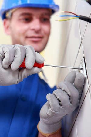 repairs: Closeup of an electrician at work Stock Photo