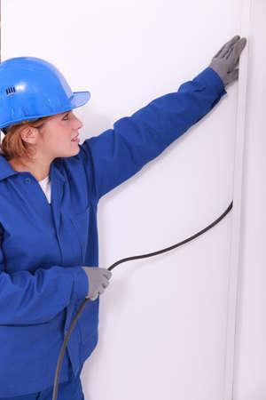 undoing: Female electrician