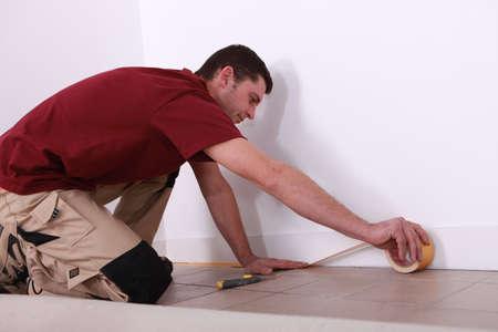 make dirty: tiler working Stock Photo
