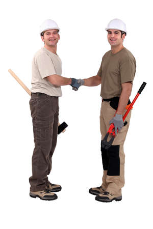 Tradesmen shaking hands photo