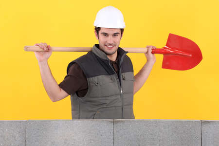 leveler: Bricklayer with spade