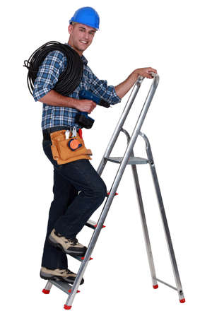 An electrician climbing a ladder. photo
