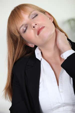 subordinated: Businesswoman with neck ache