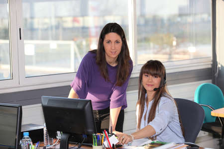 two women at work photo