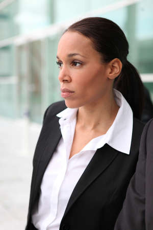 Beautiful female executive outside a corporate building photo