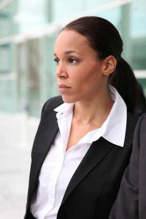 Beautiful female executive outside a corporate building photo