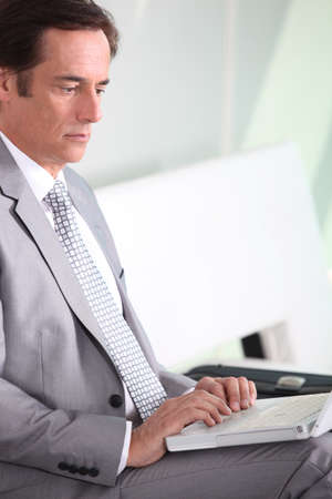 45 50 years: Businessman on laptop Stock Photo