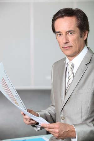 45 50 years: Executive holding bar chart Stock Photo