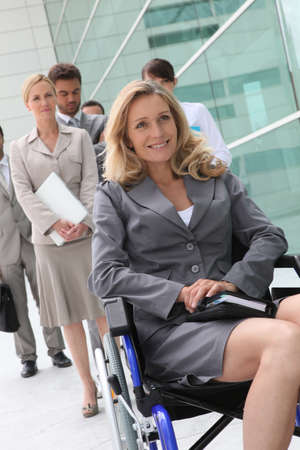 handicapped accessible: Successful businesswoman in wheelchair