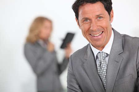 look pleased: Businessman laughing