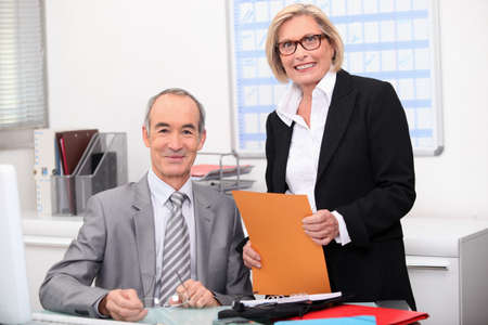 Older couple working in an office Stock Photo - 11775302