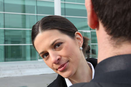 Business woman looking over a colleagues shoulder photo