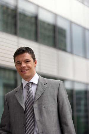 mid age: Businessman stood outside office