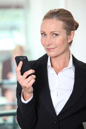 Mature woman using smartphone photo