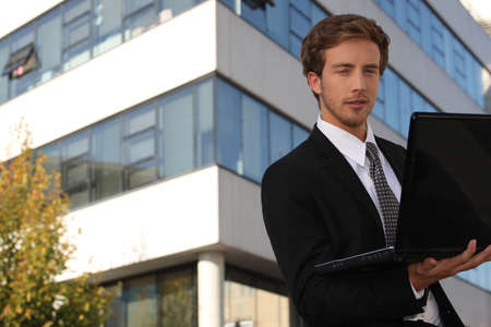 young executive in front of building photo