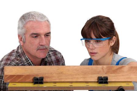 Carpenter and female apprentice photo