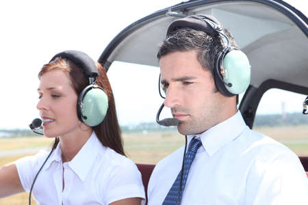 skipper: Man and woman in a light aircraft Stock Photo