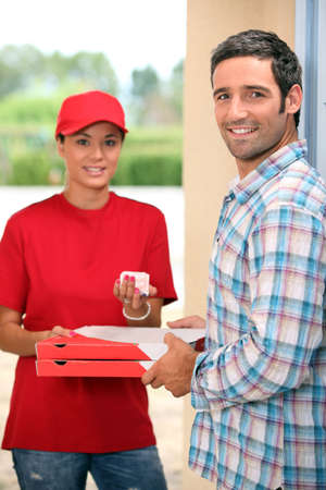 sideburns: pizza delivery receiving payment Stock Photo