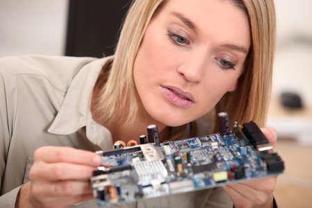 hair part: woman repairing pc