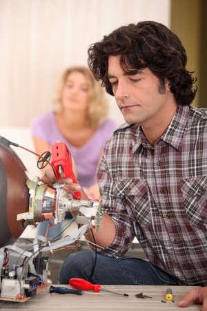 cathode ray tube: Man repairing television set