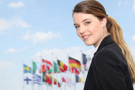 Businesswoman in front of flags photo