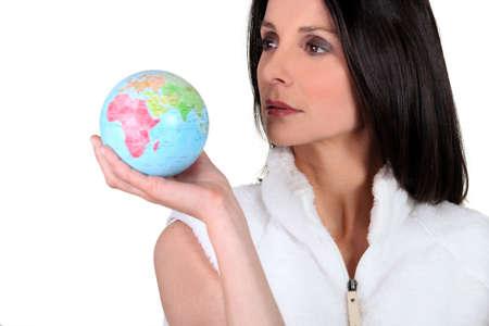 bionomics: Woman holding small globe
