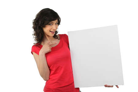 displays: Woman in red pointing at a board left blank for your message